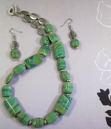 Silver and Swirling Green Puffed Glass Necklace and Earrings by TamsJewelry