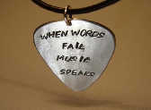 Guitar pick pendant when words fail music speaks
