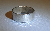 Hammered sterling silver ring with radiant shine