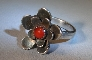 Sterling silver flower ring with iridescence and red coral stone