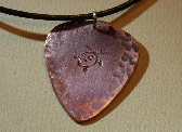Iridescent guitar pick pendant handmade from copper