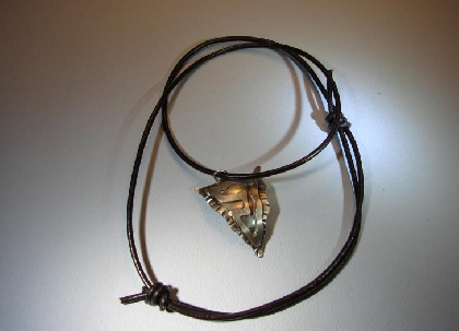 Sterling silver arrowhead pendant with rich patina finish