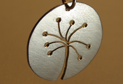 Dandelion pendant hand sawed from sterling silver
