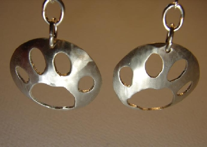 Paw print earrings in sterling silver domed with stunning cutting outs