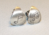Guitar pick shaped sterling silver stud earrings with music notes
