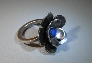 Sterling silver flower ring with blue lapis lazuli stone