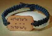 Blue hemp bracelet or anklet with a personalized copper latitude longitude tag