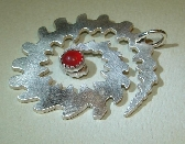 Sterling silver spiral galaxy M74 shaped pendant with red coral center