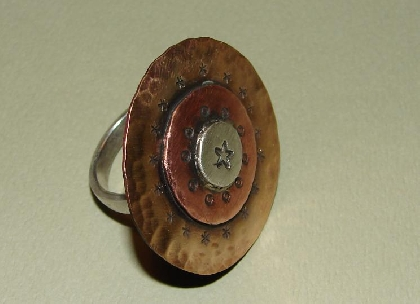 Handmade ring with artistic combination of bronze copper and sterling silver