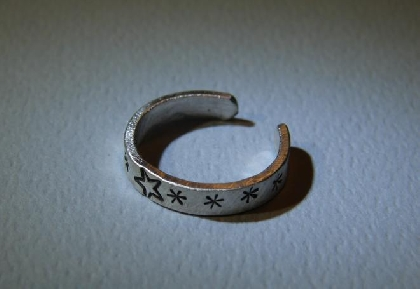 Sterling silver toe ring with array of playful stars