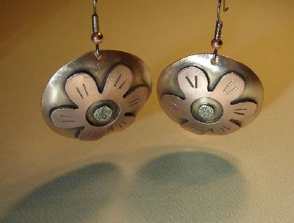 Disc earrings with lilies in a fusion of bronze copper and sterling silver
