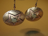 Star earrings in a fusion of sterling silver bronze and copper