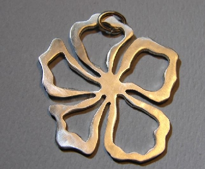 Sterling silver wavy hibiscus flower pendant