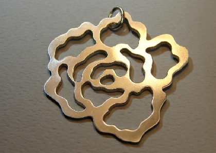 Sterling silver rose pendant with cut outs