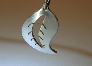 Leaf pendant in sterling silver with flowing design