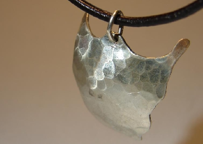 Arrowhead pendant featuring hammered sterling silver