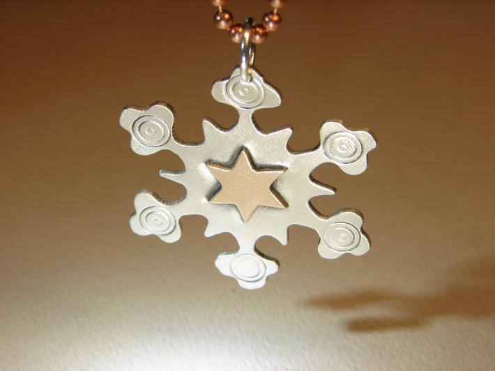 Snowflake pendant in sterling silver with bronze star