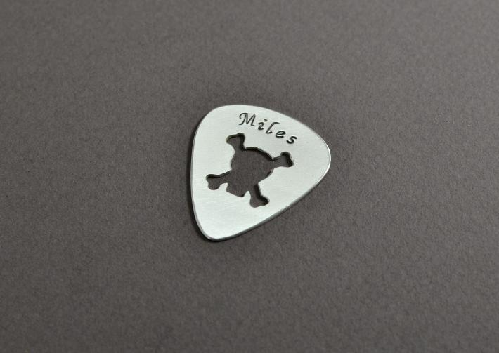 Skull and crossbones guitar pick in personalized sterling silver