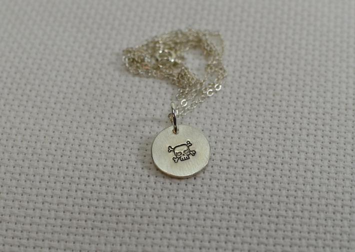 Sterling silver charm pendant with skull and crossbones