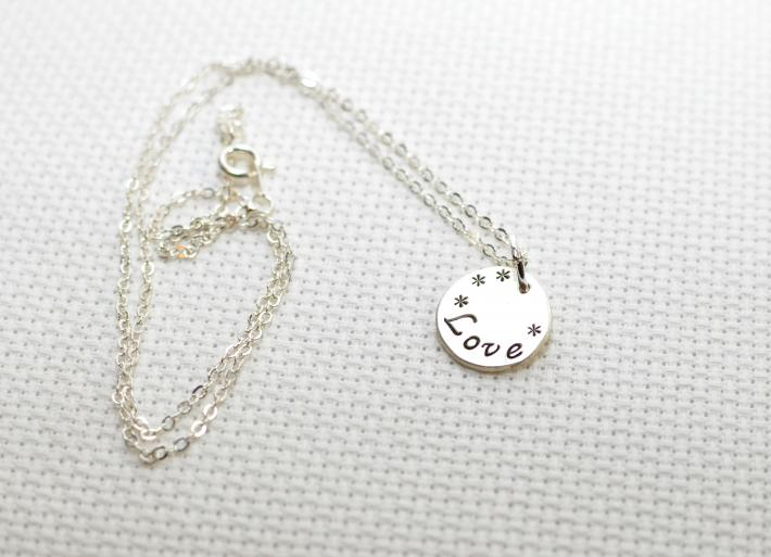 Sterling silver love charm necklace