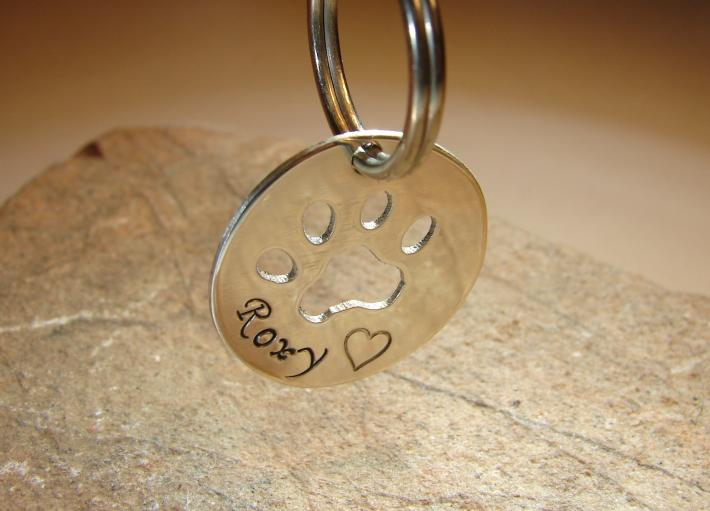 Sterling silver dog tag with personalized paw cut out