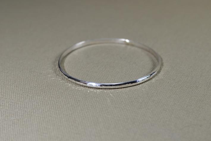 Sterling silver bangle with hammered texture