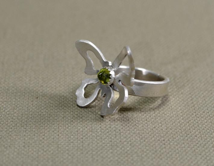 Sterling silver butterfly cocktail ring with deep green Peridot