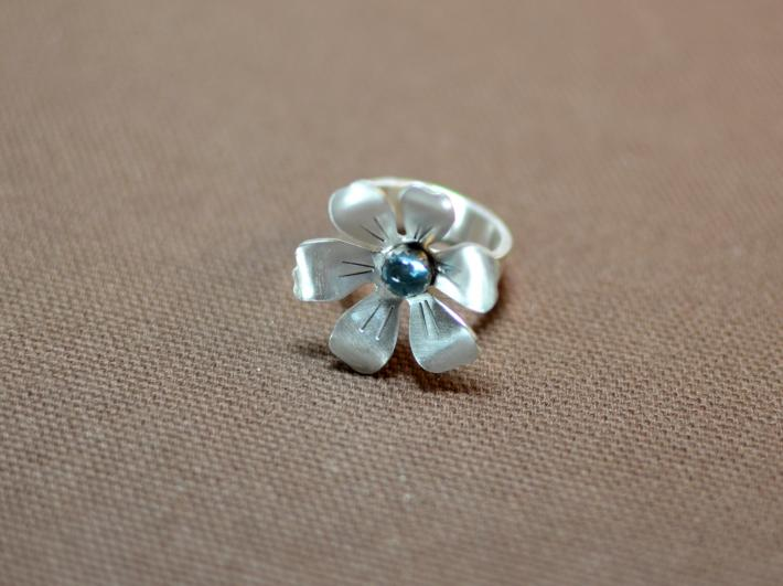 Full bloom sterling silver flower ring with blue topaz