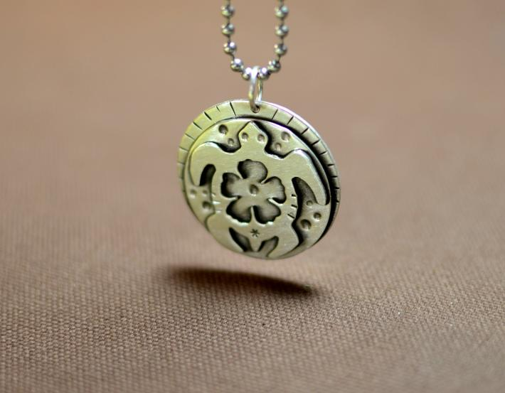 Sterling silver sea turtle with hibiscus flower peace pendant