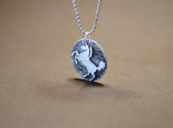 Sterling silver unicorn shadow pendant