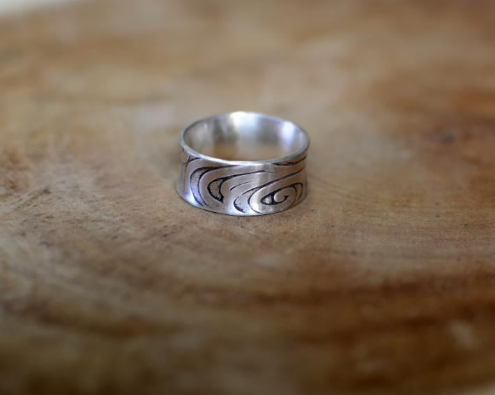 Swirling sterling silver anticlastic ring