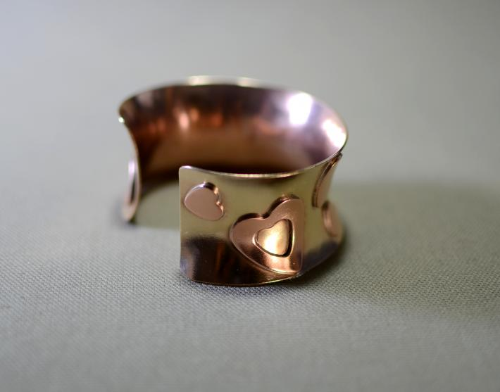 Bronze anticlastic copper heart cuff bracelet