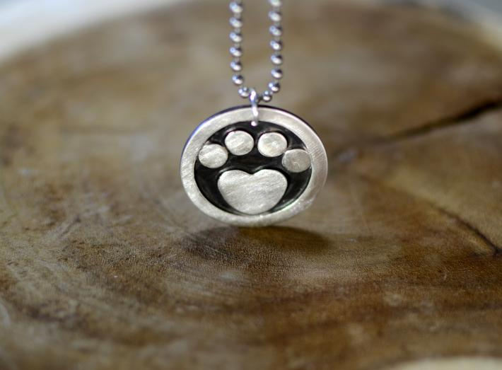 Animal paw sterling silver medallion