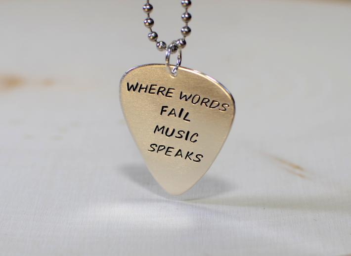 Sterling silver guitar pick pendant where words fail music speaks