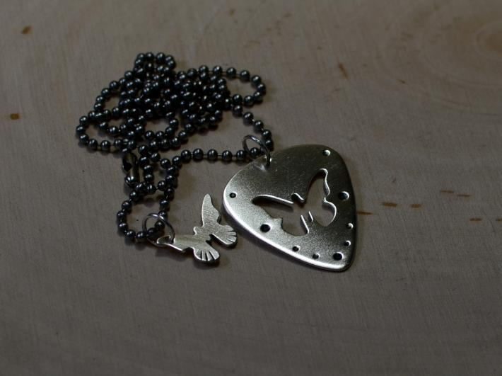 Steling silver necklace with guitar pick and butterfly charm