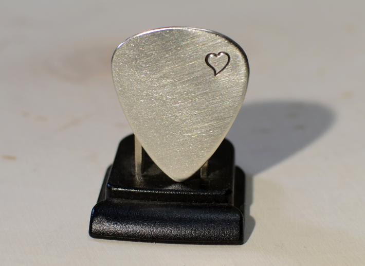 Guitar pick with loving heart in sterling silver
