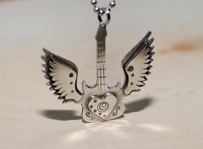 Winged guitar in sterling silver