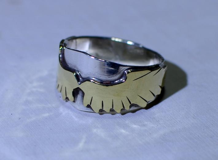 Sterling silver ring with soaring brass wings