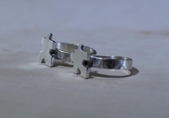 Interlocking puzzle pieces friendship rings in sterling silver